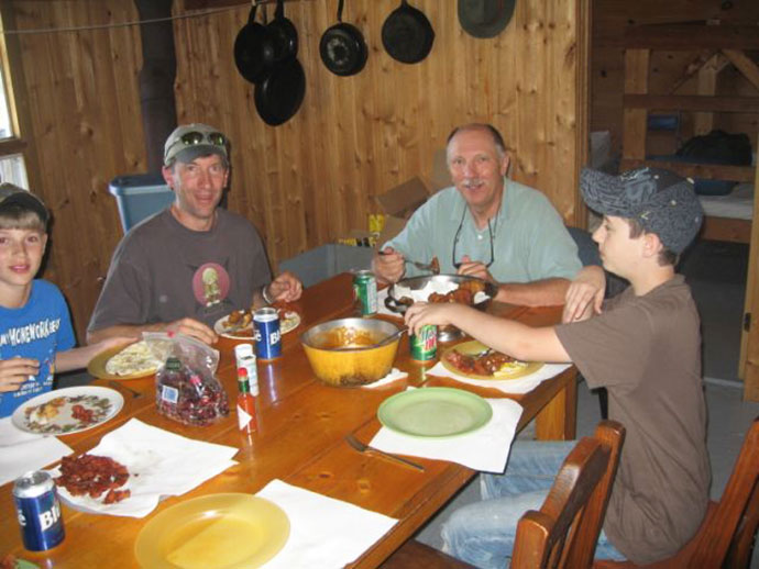 Enjoying a meal together at Wapesi Lake in Northern Ontario, Canada